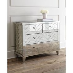 Regina-Andrew Design Troy Chevron Mirrored Chest ($1,899) ❤ liked on Polyvore featuring home, furniture, storage & shelves, dressers, antique mirror, eglomise furniture, hand made furniture, mirrored glass furniture, mirrored glass dresser and handcrafted furniture