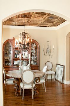 Dining room with salvaged ceiling tin,  salvaged gothic 1920's hutch