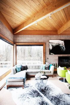 A cabin in Aspen with cool dove grays, lively neon accents, and large windows