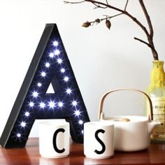 DIY Light Up Letter with cardboard and fairy lights. Click to see the tutorial.