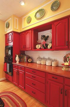 Moms basement kitchen with gray walls. Floors, big windows, eben the yel soffit. Farmhouse Kitchen Cabinets, Soffits In Kitchen, Red And White Kitchen Cabinets, Yellow Kitchen Walls, Yellow Kitchens, Red Kitchen Decor, Pale Yellow Walls, Mustard Yellow Walls, Gray Walls