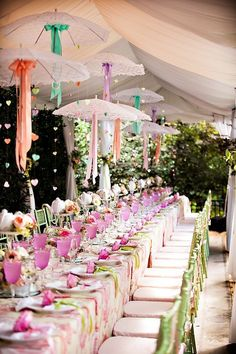 Pink & green theme tablescape with colored ribbons hanging from suspended vintage lace parasols. stylemepretty.com #tablescape #parasols #lace #vintage