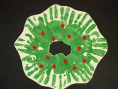 Hands and Fingers Wreath: Little hands and fingers make this easy Hands and Fingers Wreath. A great Christmas craft for Toddlers and Preschoolers