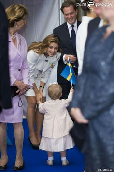 Princess Madeleine and her husband Chris O'Neill with their niece Princess Estelle celebrate King Carl Gustaf's 40th year on the throne during the City of Stockholm celebration on 15 Sept 2013.