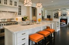LOVE the pops of orange in this otherwise white, marble, and stainless kitchen.  So works with the blues and pinks of my dream office, breakfast, and dining rooms!