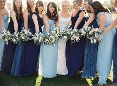 mismatched navy bridesmaids dresses are perfect for anytime of the year! Mix and match pastel blues, teal, and navy of the perfect palette! See more mismatched bridesmaids dress ideas at the link below. http://www.thebridelink.com/blog/2014/03/25/mismatched-purple-and-lavender-bridesmaid-dress-ideas/ by Virgil Bunao