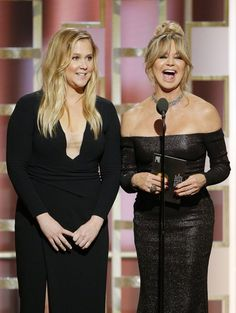 Presenters Amy Schumer and Goldie Hawn are seen onstage during the 74th Annual Golden Globe Awards.