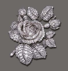 """The Tudor Rose"" brooch made by Theodore Fester, circa 1855 Designed as a large sculpted rose blossom, entirely decorated by old European, old mine and rose-cut diamonds, mounted in silver-topped gold, circa 1855, in a red leather fitted case. According historical documents, the brooch is said to contain, 2,637 brilliants totallying 136 carats and 860 small rose cuts diamonds of unknown weight."