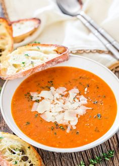 Roasted Tomato Soup - roasting tomatoes brings out the sweetness in tomatoes giving your a rich and smooth delicious soup loaded with lots of fresh herbs.