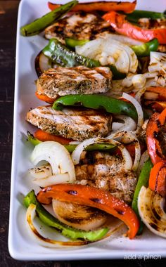 Grilled Pork Loin with Peppers and Onions makes quick and easy dish perfect for a weeknight or weekend meals! // addapinch.com