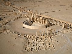Palmyra (/ˌpælˈmaɪrə/; Aramaic: ܬܕܡܘܪܬܐ Tedmurtā ; Arabic: تدمر Tadmor) was an ancient Semitic city in present Homs Governorate, Syria. Archaeological finds date back to the Neolithic, and it was first documented in the early second millennium BC as a caravan stop for travellers crossing the Syrian Desert.