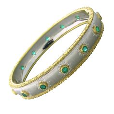 Buccellati Gold Emerald Bangle Bracelet | From a unique collection of vintage bangles at http://www.1stdibs.com/jewelry/bracelets/bangles/