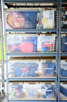 Organized garage using well labelled clear containers.