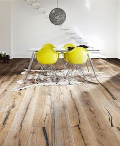 LOVE #reclaimedWood used to warm up a contemporary space. yellow #eames? yes please! #hermanMiller #moooi