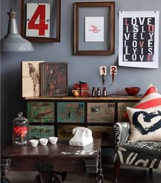 I'm drawn to the refurbished wood, use of typography & the splashes of red in this room...really great space!