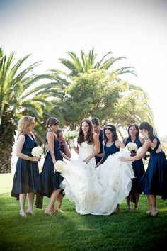 Short, navy blue bridesmaid dresses | @VieraPhoto | Brides.com