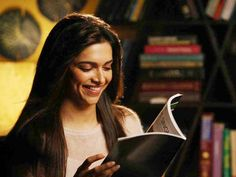 Photo of Deepika Padukone smiling while reading a book in Yeh Jawani Hai Deewani Deepika Padukone Movies, Deepika Ranveer, Discipline Priest, Dipika Padukone, Meant To Be Together, Photography Pics, I Love Girls, Indian Celebrities, Bollywood Actors