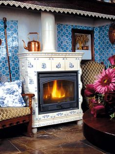 Régnier-yveline - nice tiles fire stove in an old chimney space.