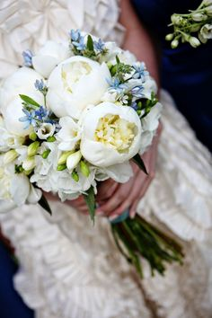Love this bridal bouquet... Paritcularly the way the green buds and small blue flowers accentuate the mostly white flowers.