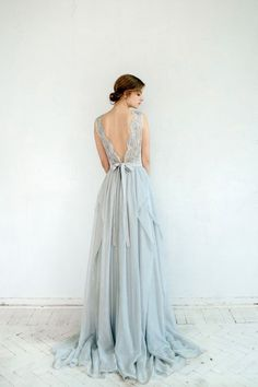 Featuring floaty blue-gray chiffon and delicate lace embroidered with silvery beadwork, this handmade gown is a vision of loveliness. #weddingdress