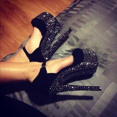 Cool black pumps with black rhinestones on the wedge, heel, and under side. Has a thin black buckle strap.