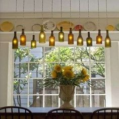 10 Creative New Ways to Use Old Bottles. This is such a cool look! Use our LED lights to make these bottles sparkle from www.maxximastyle.com