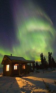 Northern Lights dance over a cabin in Fairbanks, Alaska