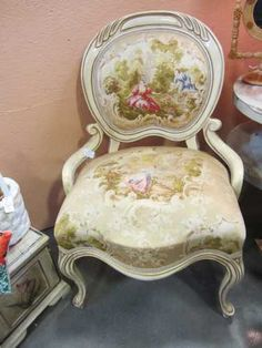 """Beautiful French Louis Provincial-style sitting chair - ornate wood frame with pattern satin-like fabric. No rips, tears, or stains. Measures: 24"""" x 34"""" x 19"""".  $75.00"""