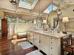 A spacious bathroom with a double vanity, skylights, and a luxurious shower. Did you notice the lantern-style lights and suspended mirrors? Source: http://www.zillow.com/digs/Home-Stratosphere-boards/Luxury-Bathrooms/