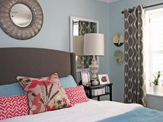 Calming blue sets the scene for this master bedroom. An upholstered gray bed pairs with soft blue and white bedding.