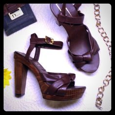 Sky-high Michael Kors Maya brown leather sandal Absolutely stunning and brand new, never worn authentic sandals by Michael Kors. Color is dark brown, buttery soft leather, solid wood heel. Comes with box but no top. Box says it's a wide width (W) but it's a medium width. I meant to buy the wide but the associate put the wrong pair in the box and I was across the world when I realized this... Hence why I never wore them. Purchased at Lane Crawford in Hong Kong.  Haven't seen the brown in the…