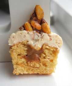 filled with toffee sauce, topped with praline buttercream and almond ...