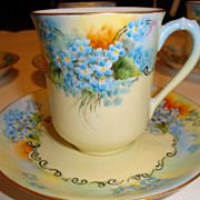 So many forget how lovely oranges and blues can be.  - Limoges Demi Cup and Saucer with Forget Me nots