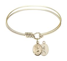 """St. Rita Baseball Charm On A 6 1/4 Inch Round Eye Hook Bangle Bracelet. Bracelet is heavy -plated with """"Hamilton Gold"""" a real gold plate alloy designed to match the deep gold color typical of 14 karet gold filled medals. The Gold Filled St. Rita Baseball charm measures 1/2 x 1/4 inches. Made in the USA by a New England jewelry manufacturer with over 100 years experience in creating beautiful, quality jewelry. Saint Rita of Cascia is the patron saint of Loneliness/Lost Causes. Memorial Day..."""