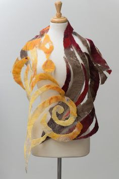 Nuno Felted silk scarf with beautiful spiral and leaves pattern in shades of Olive, dark red to light yellow. The fabric is loose woven Japanese silk: