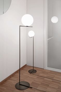 "The IC Lights family was recently debuted for FLOS and designed by Michael Anastassiades ranges from wall lamps in brass to floor lamps in a bronze finish. The design was inspired by ""the awkwardly positioned spinning spheres of contact jugglers""."