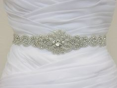 I think this is the winner!!  MYRA   Crystal Rhinestone Bridal Sash Wedding by HannabellaDesigns, $110.00