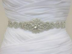 I think this is the winner!!  MYRA   Crystal Rhinestone Bridal Sash Wedding by HannabellaDesigns, $110.00