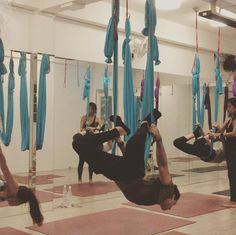 Camel pose with hammock in aerial yoga class #HammerAerialYoga Http://www.hammeraerialyoga.com