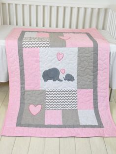 A brand new colour combination of the elephant blankets, a gray and pale baby pink - white quilt to match with a baby bedroom. The cute elephant baby blanket nice for girls , with different colours of course. I used the timeless chevron pattern, and made the applications with patchwork technique. Can be made any size and colour, or with different applications. On this custom made quilt set each applique is hand stitched. The entirely handcrafted baby quilt bedding is quilted with batting…