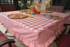 Fitted, ruffled tablecloth tutorial. Not a fan of the colors here, but I have an idea for adapting this!