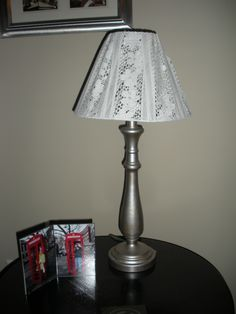 My DIY thrift store lamp with a lace lamp shade. I plan on using this in my nursery one day.