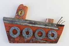 Hand Crafted Driftwood Boat: Rustic fishing boat made from driftwood and found objects