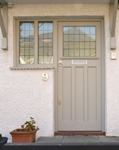 Minimalist style grey front door and frame with clear, leaded panes, hand-painted contemporary finish and chrome door furniture. Cottage Front Doors, Grey Front Doors, Front Door Porch, Cottage Door, Wooden Front Doors, House Front Door, Painted Front Doors, Glass Front Door, House Doors