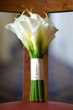 Calla Lillies are always a nice option by they come in so many colors. So if you want something simple you can do yours in white and the girls' in your wedding or accent colors