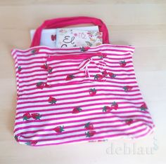 DIY Tshirt Tote by deblaucrafts: a great way to recycle old Tshirts... I'd like to try baby onesies too. For smaller results, obviously.