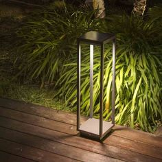 Bollard light with three hours of operation. Made of grey aluminium, with 23 W LED illumination, 180 degree angle and presence sensor at six metres. Outdoor Path Lighting, Bollard Lighting, Landscape Lighting, Public Architecture, Garden Architecture, Path Lights, Outdoor Flooring, Wood Lamps, Metal Projects