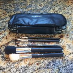 MAC brush and case set 166, 263, 212, 136, 209 This is a set of mac brushes total of five with case all new and never used was a gift from my sister-in-law who is a make up artist. MAC Cosmetics Makeup Brushes & Tools