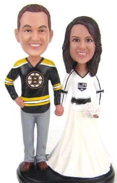 custom sculpted wedding cake topper with bruins and kings hockey jerseys is sculpted to look like