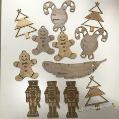 Look how pretty these are finished!   #lasercut #wood #christmas #gifttags #gifts #presents #custommade #unique #pretty #christmastree #candycanes #gingerbreadman #nutcracker #feathers by thepineapplepress